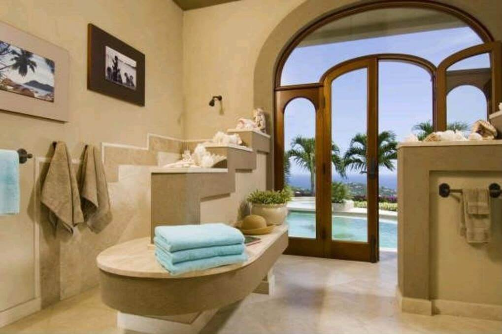 Island Sophistication in Guest Bath which Leads out to the Pool