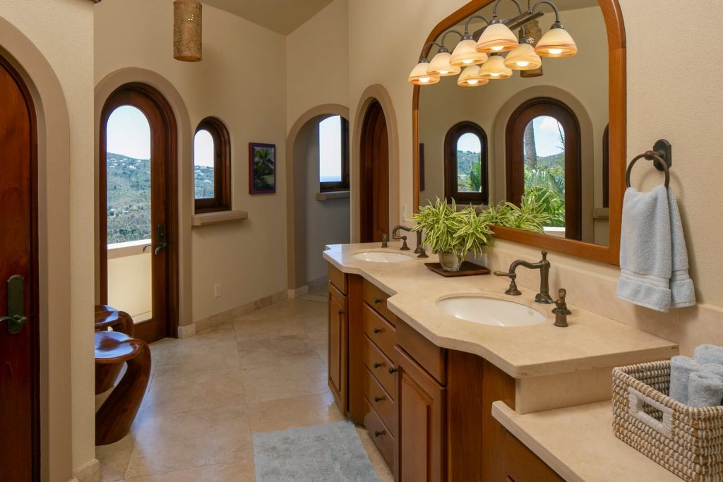 Master Bath with Double Sinks and Travertine Countertops
